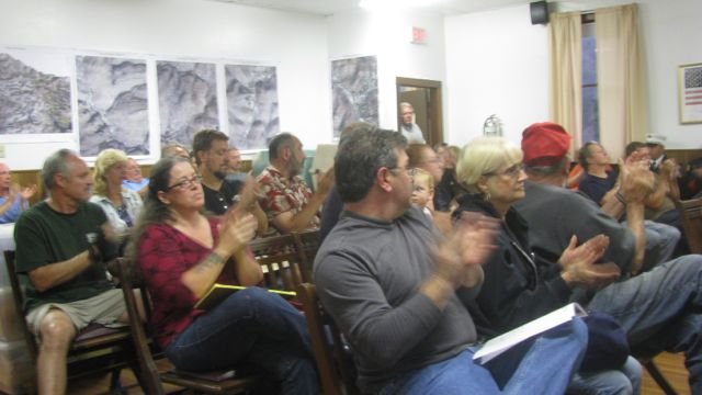 Citizens attending the Sept 12, 2011, Town Board meeting, applauding people who helped out in the flood: Photo by Rusty Mae Moore