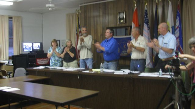Standing applause for Supervisor Stanley, L-R Town Clerk Frasier, Councilperson Bartlett, Councilperson Malloy, Supervisor Stanley, Councilmember Jordan, Councilmember Bernstein